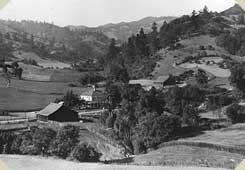 View of a lovely valley, full of meadows and clumps of trees, a home, and a barn